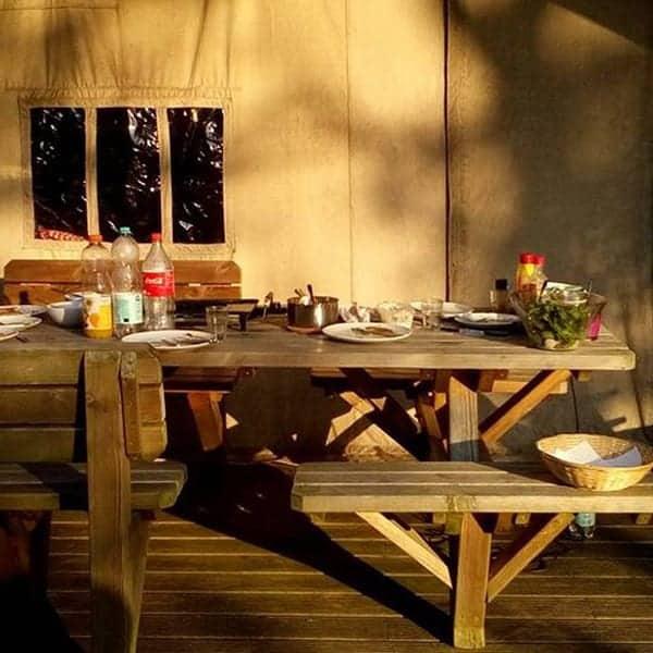 Glamping op de Veluwe bij Minicamping Uylkenshof in de ondergaande zon